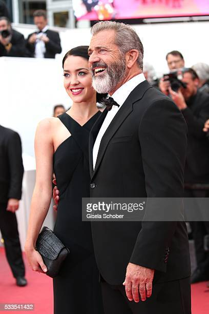 Mel Gibson and his girlfriend Rosalind Ross attend the closing ceremony of the 69th annual Cannes Film Festival at the Palais des Festivals on May 22...