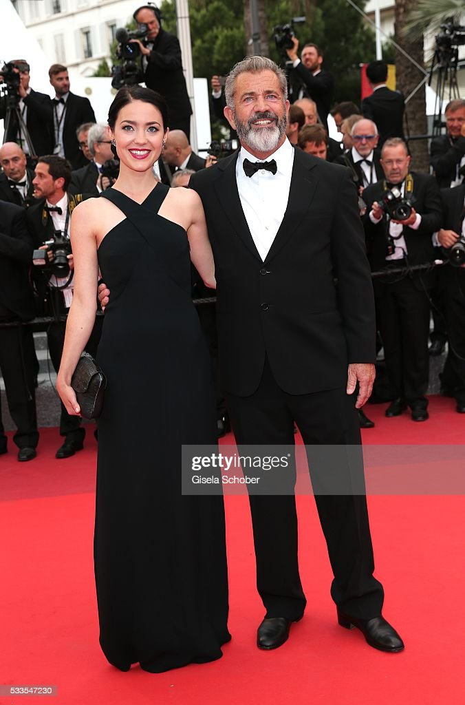 Mel Gibson (R) and his girlfriend Rosalind Ross attend the closing ceremony of the 69th annual Cannes Film Festival at the Palais des Festivals on May 22, 2016 in Cannes, France.