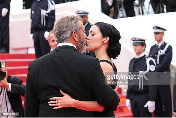 Mel Gibson and his girlfriend Rosalind Ross kiss during the closing ceremony of the 69th annual Cannes Film Festival at the Palais des Festivals on...