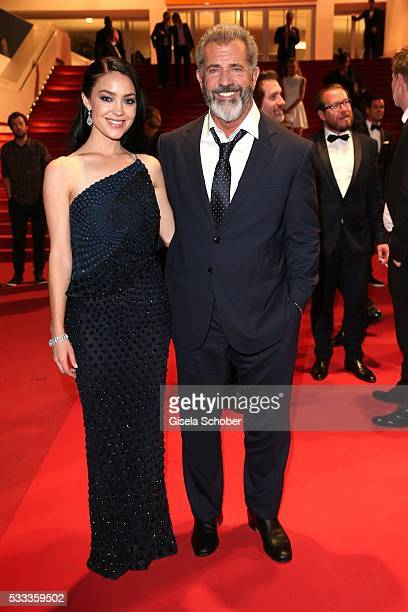 Mel Gibson and his girlfriend Rosalind Ross leave the Blood Father Premiere during the 69th annual Cannes Film Festival at the Palais des Festivals...