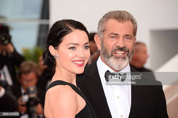 Mel Gibson and Rosalind Ross attend the closing ceremony of the 69th annual Cannes Film Festival at the Palais des Festivals on May 22 2016 in Cannes...
