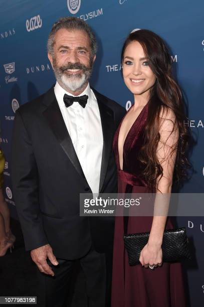 Mel Gibson and Rosalind Ross attends Michael Muller's HEAVEN presented by The Art of Elysium on January 5 2019 in Los Angeles California