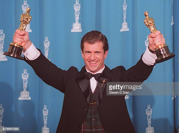 Mel Gibson holds his dual Oscars at the 1996 Academy Awards ceremony in Los Angeles Gibson won the award for Best Director for his film Braveheart...