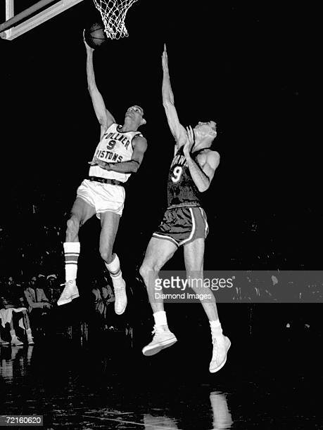 Mel Hutchins of the Fort Wayne Zollner Pistons drives for a layup as Bob Pettit of the St Louis Hawks tries to block the shot during a Western...