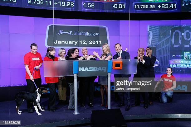 Mel Karmazin Beth Stern and Bruce Aust ring the NASDAQ closing bell at NASDAQ on January 12 2011 in New York City