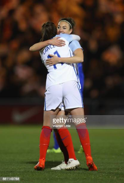 Mel Lawley of England celebrates scoring the first goal with Jodie Taylor of England during the FIFA Women's World Cup Qualifier between England and...
