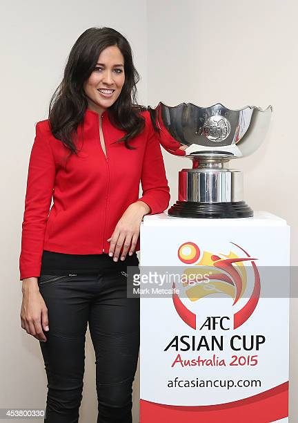 Mel McLaughlin poses with the Asian Cup Trophy during the AFC Asian Cup Media Ambassador Announcement at Museum of Contemporary Art on August 19 2014...