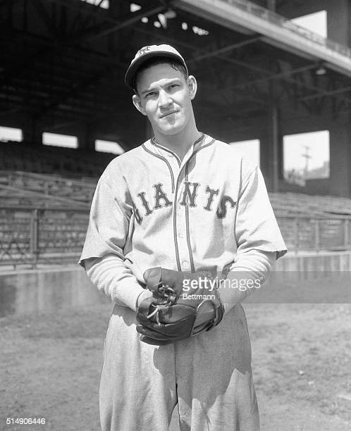 Mel Ott, one of the hardest hitters the Giants own, is shown in a 3/4-length shot with glove on hand.