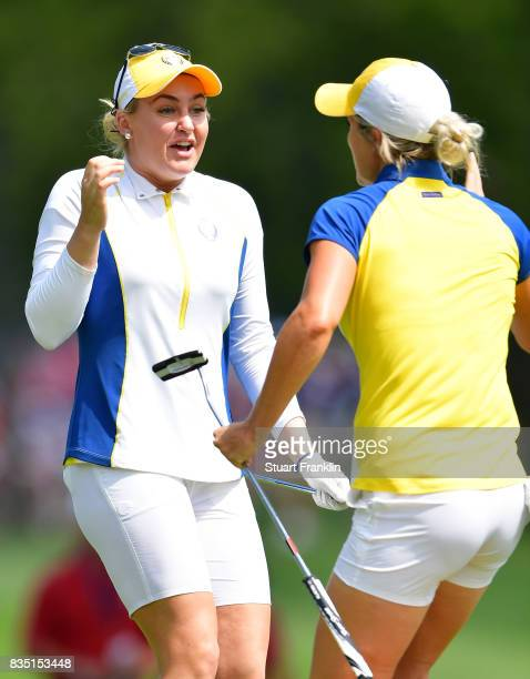 Mel Reid and Charley Hull of Team Europe celebrate during the morning foursomes matches of The Solheim Cup at Des Moines Golf and Country Club on...