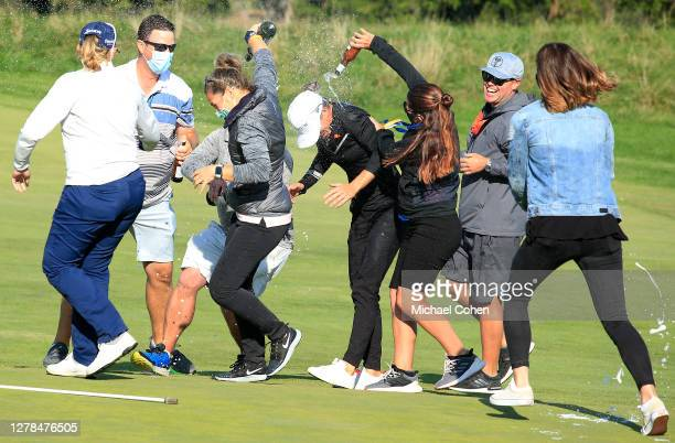 Mel Reid of England is doused with champagne after winning the ShopRite LPGA Classic presented by Acer on the Bay Course at Seaview Hotel and Golf...