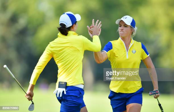 Mel Reid of Team Europe celebrates with Carlota Ciganda during the second day afternoon fourball matches of The Solheim Cup at Des Moines Golf and...