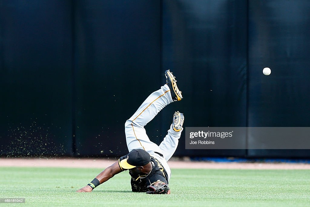 Mel Rojas Jr. #81 of the Pittsburgh Pirates dives but is unable to catch a fly ball in center field during the game against the Toronto Blue Jays at Florida Auto Exchange Stadium on March 3, 2015 in Dunedin, Florida. The Pirates defeated the Blue Jays 8-7.