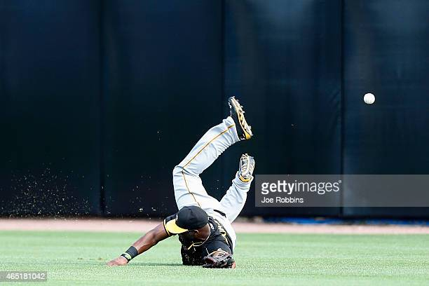 Mel Rojas Jr #81 of the Pittsburgh Pirates dives but is unable to catch a fly ball in center field during the game against the Toronto Blue Jays at...