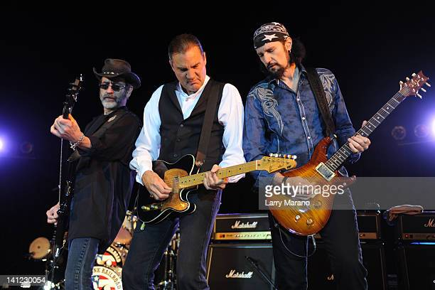 Mel Schacher Max Carl and Bruce Kulick of Grand Funk Railroad perform at Seminole Casino Coconut Creek on March 12 2012 in Coconut Creek Florida
