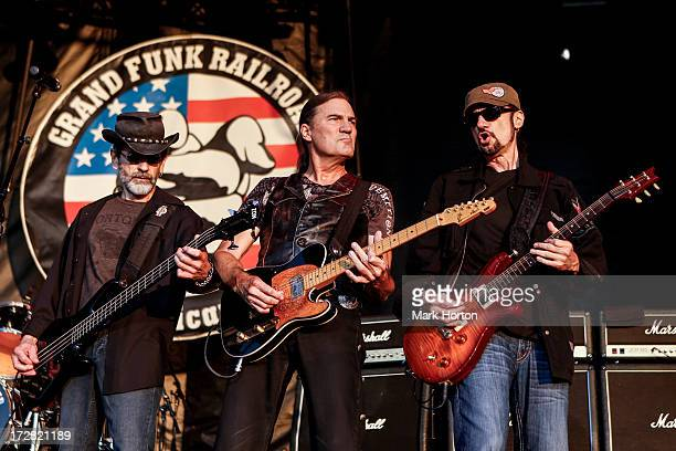 Mel Schacher Max Carl and Bruce Kulick of Grand Funk Railroad perform on Day 1 of the RBC Royal Bank Bluesfest on July 4 2013 in Ottawa Canada