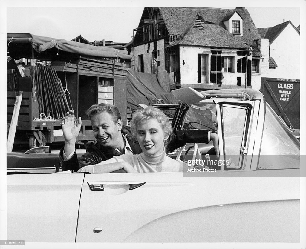 Mel Torme and Elinor Donahue greet friend before filming begins for 'Girls Town', 1959.