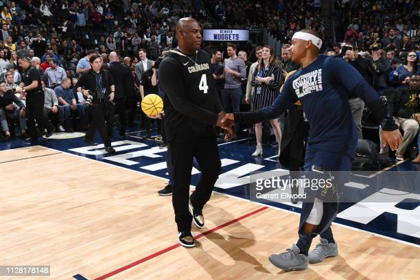 Mel Tucker head football coach at the University of Colorado Boulder shakes hands with Isaiah Thomas of the Denver Nuggets before the game against...