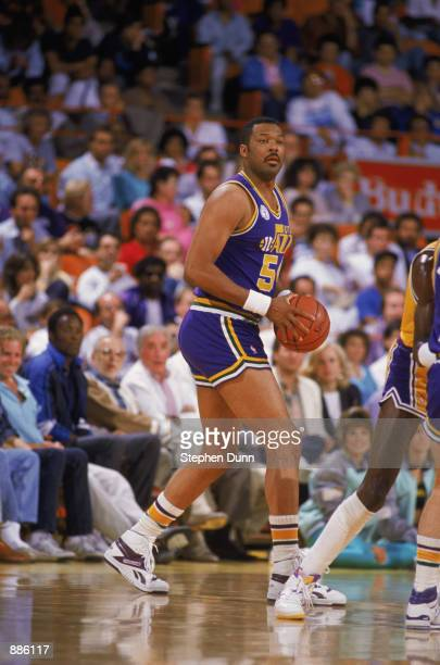 Mel Turpin of the Utah Jazz dribbles the ball during an NBA game at The Salt Palace in Salt Lake City Utah in 1988