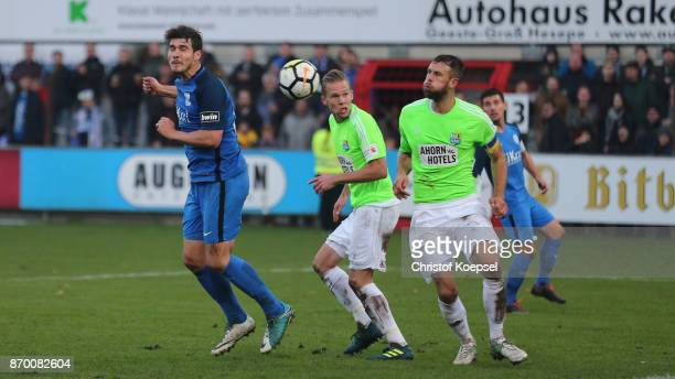mel30 of Meppen scores the first goal against Dennis Grote and Marc Endres of Chemnitz during the 3 Liga match between SV Meppen and Chemnitzer FC at...