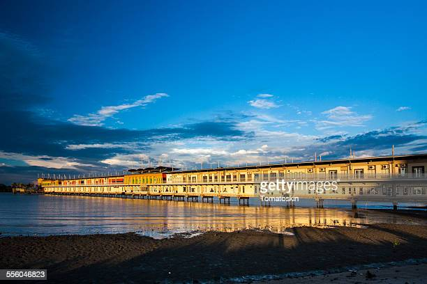 melacca pier - longhouse stock photos and pictures