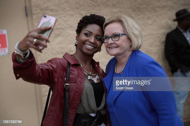Meladie Quarlles takes a selfie with Senator Claire McCaskill while the senator was greeting customers outside of a Walmart store on November 4 2018...