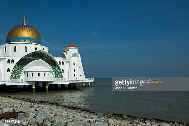 Melaka Straits Mosque or Masjid Selat Melaka combines Middle Eastern and Malay architecture and crafttsmanship The mosque faces the Malacca Strait...