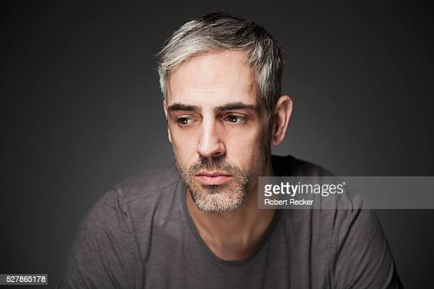 melancholic middle-aged man - disappointment stock pictures, royalty-free photos & images