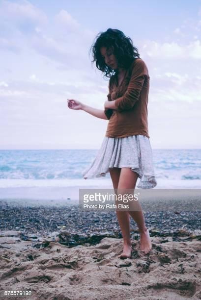 Melancholic woman on the beach