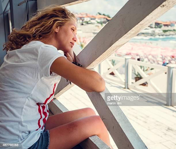 Melancholy girl at the quay