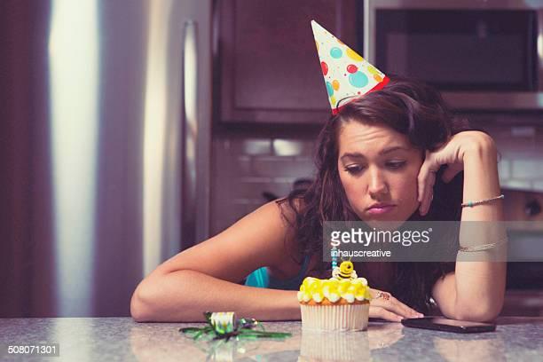 melancholy woman at home celebrating her birthday all alone - verjaardag stockfoto's en -beelden