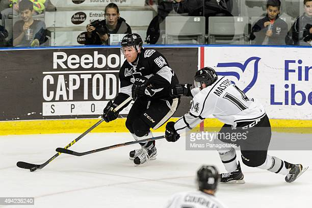 J Melancon of the BlainvilleBoisbriand Armada skates with the puck against Jonathon Masters of the Gatineau Olympiques during the QMJHL game at the...