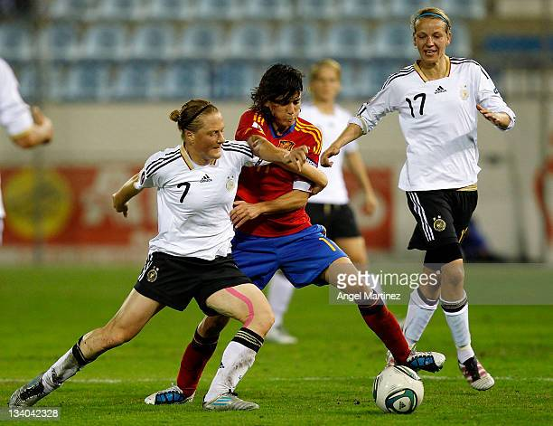 Melani Behringer of Germany fights for the ball with Sandra Vilanova of Spain during the Women's Euro 2013 qualifier group 2 match between Spain and...