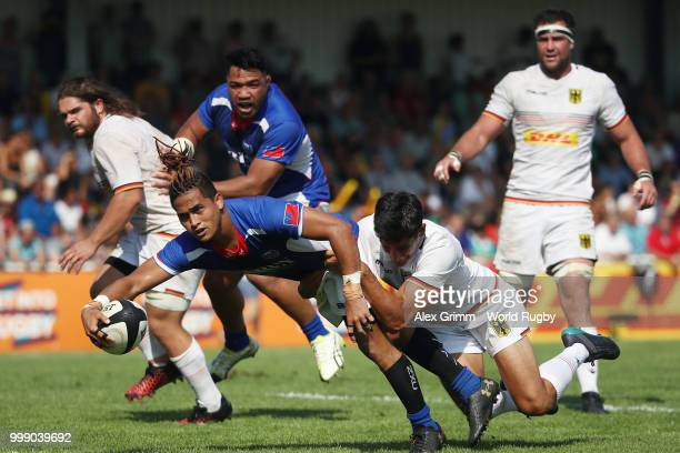 Melani Matavao of Samoa scores a try under pressure from Christopher Hilsenbeck of Germany during the Germany v Samoa Rugby World Cup 2019 qualifying...