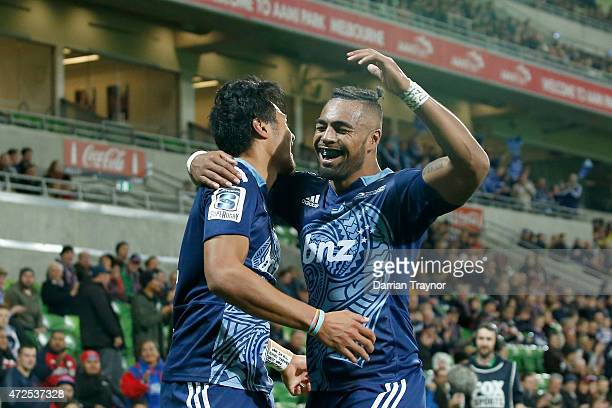 Melani Nanai and Lolagi Visalia of the Blues celebrate a try during the round 13 Super Rugby match between the Rebels and the Blues at AAMI Park on...