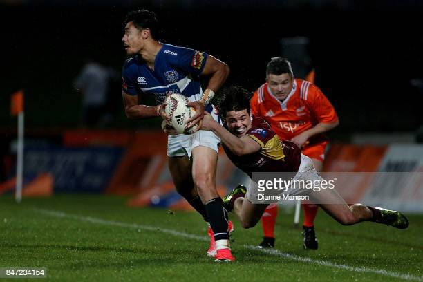 Melani Nanai of Auckland is tackled by Mike Molloy of Southland during the round five Mitre 10 match between Southland and Auckland at Rugby Park...