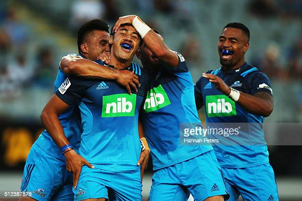Melani Nanai of the Blues celebrates after scoring a try with Male Sau and Bryn Hall during the round one Super Rugby match between the Blues and the...