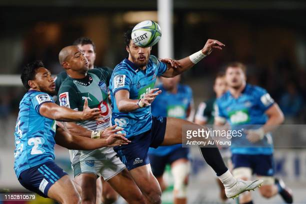 Melani Nanai of the Blues competes for a high ball against Cornal Hendricks of the Bulls during the round 16 Super Rugby match between the Blues and...