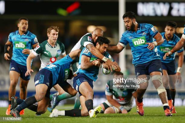 Melani Nanai of the Blues is tackled by Cornal Hendricks of the Bulls during the round 16 Super Rugby match between the Blues and the Bulls at Eden...