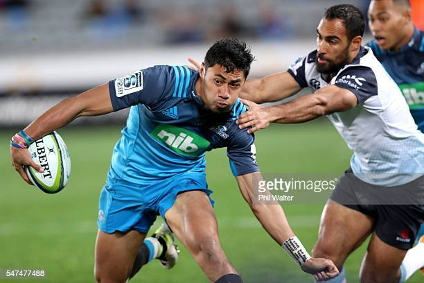 Melani Nanai of the Blues is tackled by Reece Robinson of the Waratahs during the round 17 Super Rugby match between the Blues and the Waratahs at...