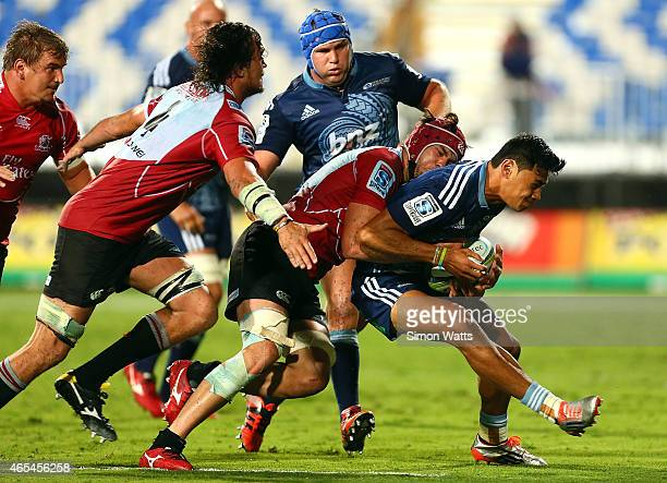 Melani Nanai of The Blues is tackled during the round four Super Rugby match between the Blues and the Lions at QBE Stadium on March 7 2015 in...