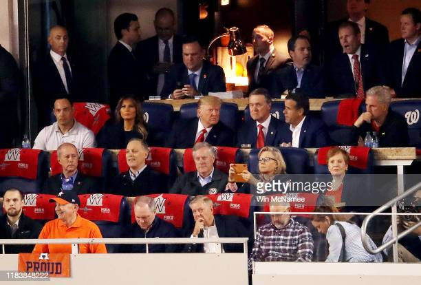 Melania and Donald Trump attend Game Five of the 2019 World Series between the Houston Astros and the Washington Nationals at Nationals Park on...