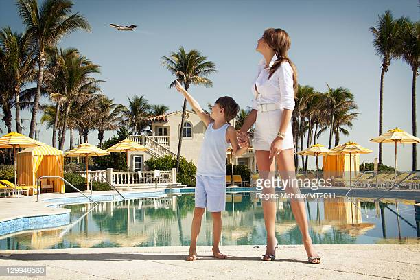Melania Trump and Barron Trump pose during a photo shoot at the MaraLago Club on March 26 2011 in Palm Beach Florida Melania's clothes by Chanel...