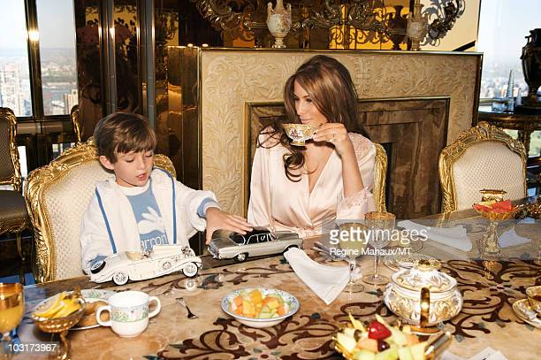 Melania Trump and her son Barron Trump pose for a photo on April 14 2010 in New York City Melania Trump is wearing a silk robe by La Perla makeup by...