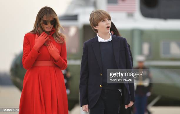 Melania Trump and son Barron arrive on Marine One to board Air Force One before departing from Andrews Air Force Base in Maryland on March 17 2017...