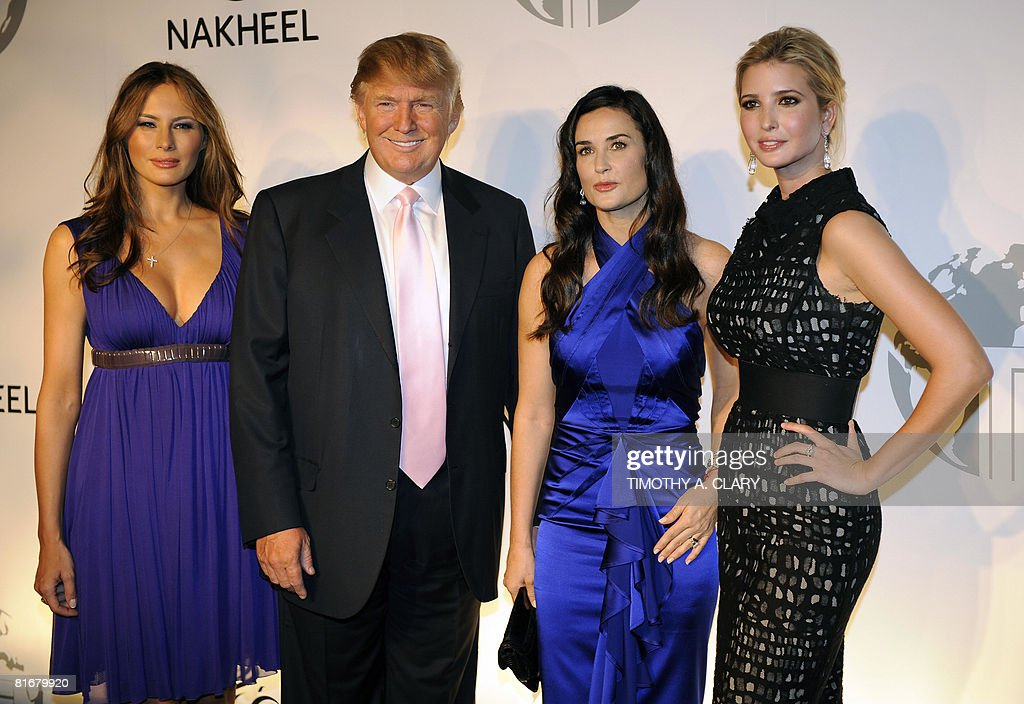 Melania Trump, Donald J. Trump, Demi Moore and Ivanka Trump pose at party at the Park Avenue Plaza in New York June 23, 2008 to introduce the Trump International Hotel & Tower Dubai .