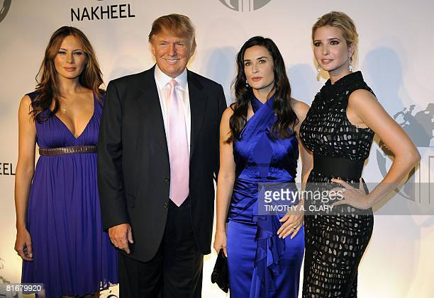 Melania Trump Donald J Trump Demi Moore and Ivanka Trump pose at party at the Park Avenue Plaza in New York June 23 2008 to introduce the Trump...