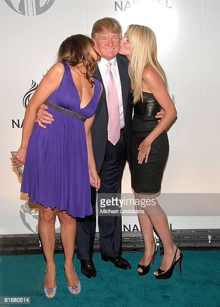 Melania Trump Donald Trump and model and TV personality Heidi Klum attend the worldwide launch of the Trump International Hotel Tower Dubai on June...