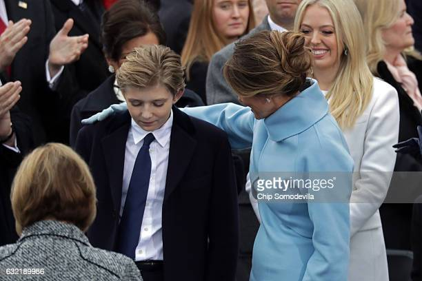 Melania Trump embraces Barron Trump on the West Front of the US Capitol on January 20 2017 in Washington DC In today's inauguration ceremony Donald J...