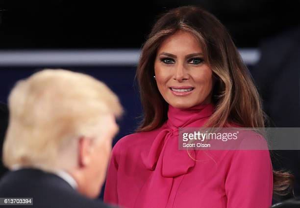 Melania Trump greets her husband Republican presidential nominee Donald Trump after the town hall debate at Washington University on October 9 2016...