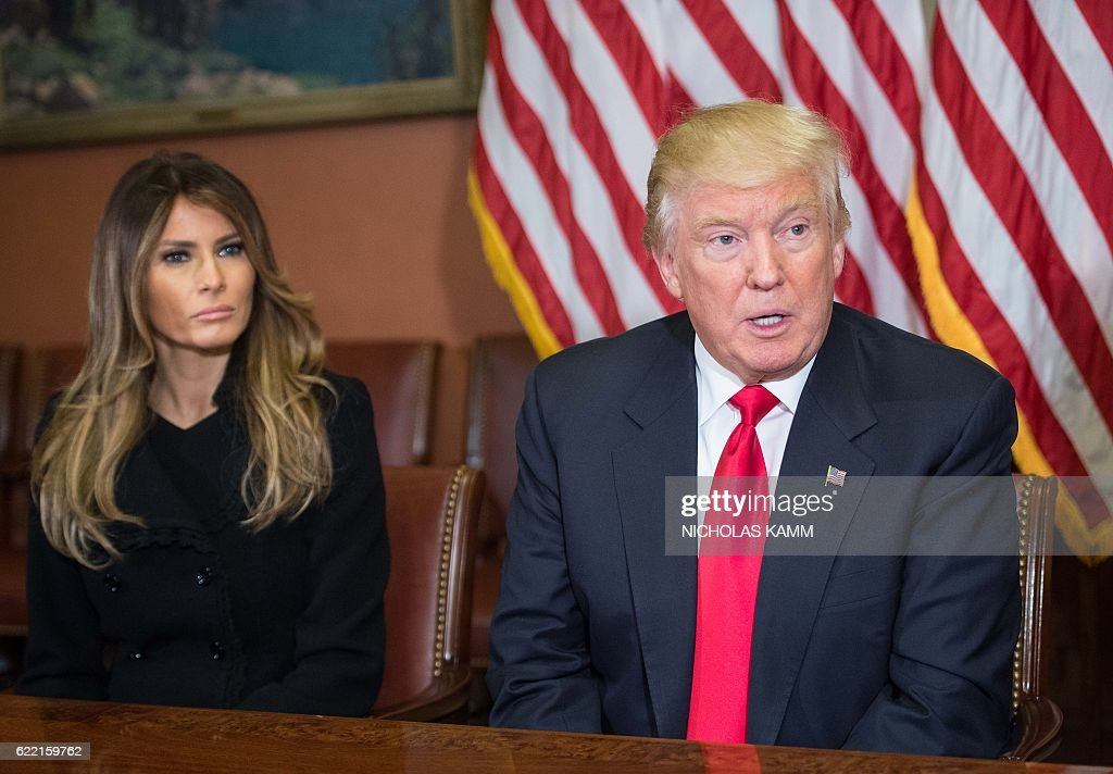 Melania Trump listens to her husband US President-elect Donald Trump speak to the press at the US Capitol in Washington, DC, on November 10, 2016. / AFP / NICHOLAS